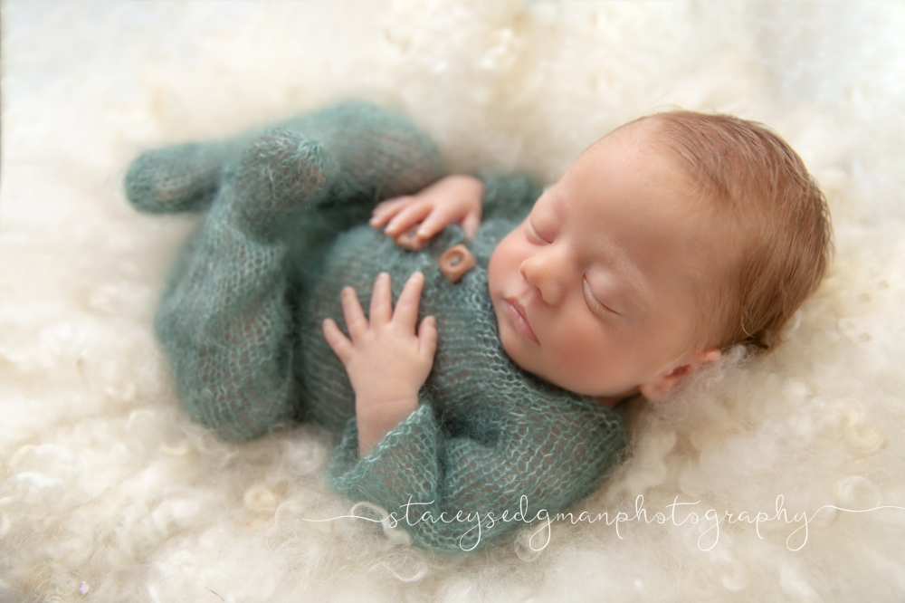 Backlit baby posed on curly felt on the Perfect Posie