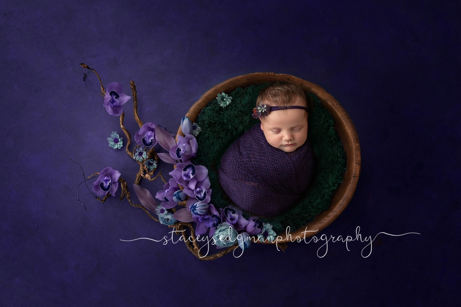 Baby in a purple wrap on a purple luisa dunn digital backdrop
