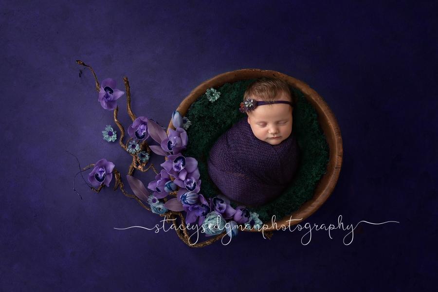 Baby in a purple wrap on a purple luisa dunn digital backdrop