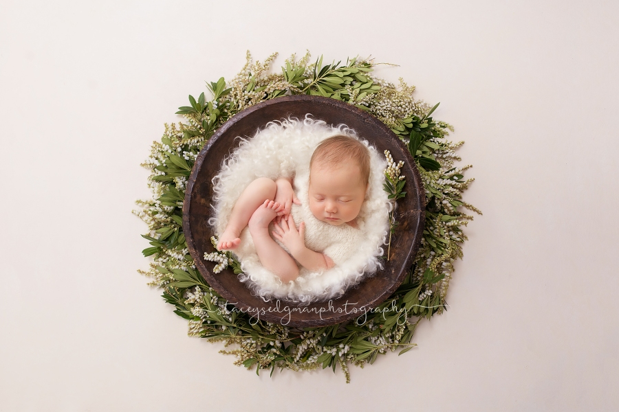 baby in cream romper in green flower wreath from luisa dunn photography
